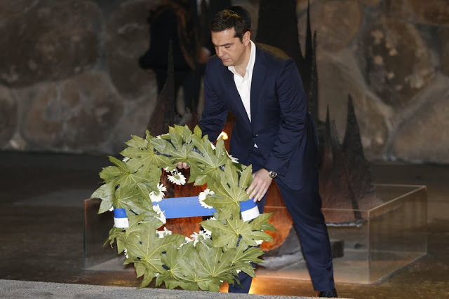 epa05040967 Greek Prime Minister Alexis Tsipras places a wreath in the 'Hall of Remembrances' in the Yad Vashem Holocaust memorial museum in Jerusalem, 25 November   2015 during a ceremony honoring the six-million Jews who perished at the hands of the Nazis during the Holocaust of World War II. Alexis Tsipras is on an official visit to Israel.  EPA/ABIR SULTAN