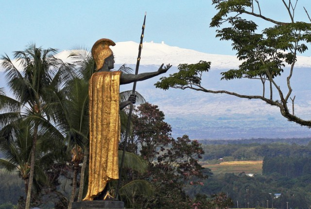 FILE - This Jan. 31, 2014, file photo, shows a statue of Hawaiian King Kamehameha I with snow-capped Mauna Kea in the distance, in Hilo, Hawaii. Part of Kamehameha's spear is missing. Police on Hawaii's Big Island are asking the public for help locating the top section of the spear, about 6 feet long, that's part of the statue of the Hawaiian warrior. Police say the spear was last seen Saturday, Sept. 5, 2015, and was reported missing Sunday. (AP Photo/Tim Wright, File)